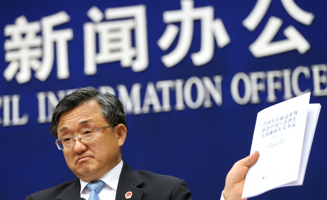 REJECTING THE RULING. Chinese Vice Foreign Minister Liu Zhenmin holds up a policy paper on China's position on the ruling of an arbitral tribunal on the South China Sea during a press conference in Beijing, China, on July 13, 2016. Photo by How Hwee Young/EPA
