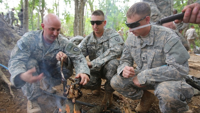 TRAINING EXERCISES: US troops learn to cook a chicken in a field environment during a jungle warfare training exercise. U.S. Marine Corps photo by Lance Cpl. Shaltiel Dominguez