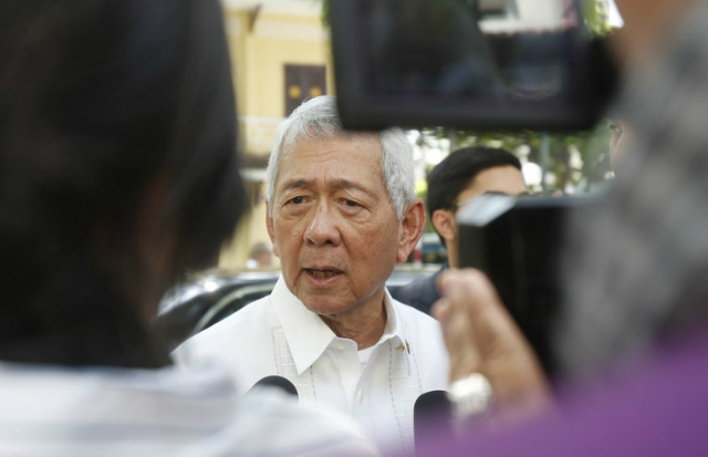 TOP DIPLOMAT. Philippine Foreign Secretary Perfecto Yasay Jr speaks with media outside a restaurant in Hanoi, Vietnam on September 29, 2016. Photo by Kham/Pool/AFP