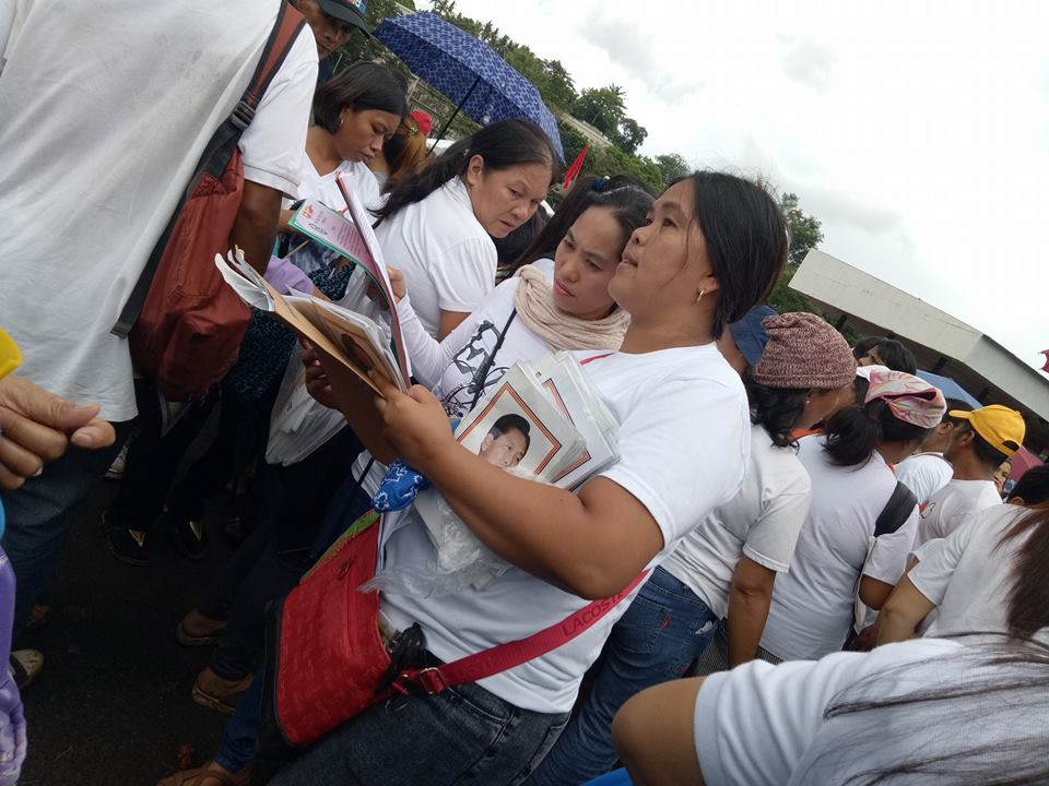 LATE STRONGMAN. Booklets detailing the achievements of former President Ferdinand Marcos are distributed during an event in UP Los Banos. Photo by Jan Jacob Jansalin/Rappler