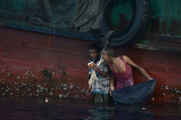 THE UNWANTED. A Rohingya migrant eats food dropped by a Thai army helicopter after he jumped to collect the supplies at sea from a boat drifting in Thai waters off the southern island of Koh Lipe in the Andaman sea on May 14, 2015. Photo by Christophe Archambault / AFP