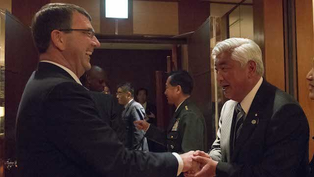 JAPAN VISIT. US Defense Secretary Ash Carter gives a challenge coin to Japanese Defense Minister General Nakatani after a dinner hosted by Nakatani at the Park Hyatt Hotel in Tokyo, April 8, 2015. Pentagon photo