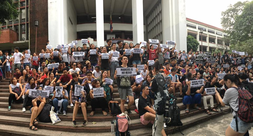 UP REMEMBERS. Students of the University of the Philippines protest in Palma Hall against the secret burial of Ferdinand Marcos. Photo by Katrina Artiaga/ Rappler