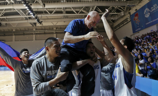 Gilas coach Tab Baldwin gets hoisted up in celebration. Photo by Singapore SEA Games Organising Committee/Action Images via Reuters