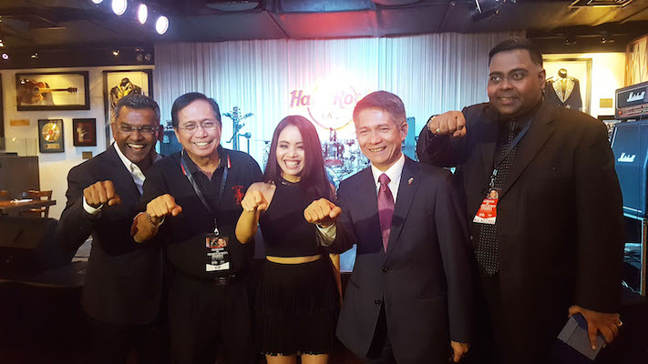 Presidential Adviser on the Peace Process Jesus Dureza (second from left) and Ambassador J. Eduardo Malaya (second from right) join concert organizers Marcus Francis (leftmost) and Datuk George Gerald (rightmost) and Davao-born Filipina singer Kris Patt (center) at testimonial concert to celebrate the presidency of Rodrigo Duterte. They all flash the iconic Duterte sign. Photo from the Philippine Embassy in KL