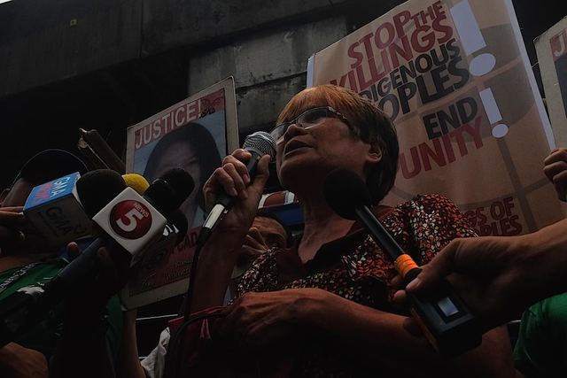 PAYMENT IN BLOOD. Linda Cadapan, mother of disappeared UP activist Sherlyn Cadapan, speaks at a rally before the NBI where Jovito Palparan is being held. Photo by Patricia Evangelista/Rappler