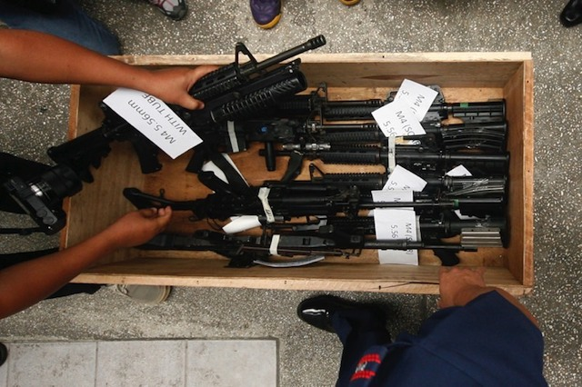 FIRST 16. Some of the 16 SAF firearms returned to the PNP by the MILF. Photo by Ben Nabong/Rappler