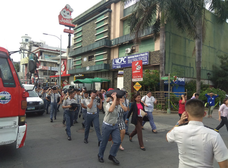 WEST QUADRANT. Employees evacuate the building during the earthquake drill. Photo by Bunsim San/Rappler
