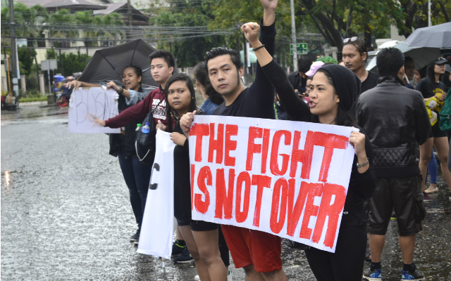 NEW GENERATION. Millennials lead the protest against the Marcos burial in Iloilo City. Photo by Russel Patina/Rappler