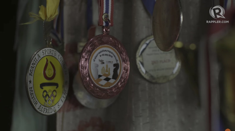 YOUNG PRODIGY. The small house where Magnus Roma and his family live is decorated by medals and trophies the family won from various chess tournaments. Photo by Vee Salazar/Rappler
