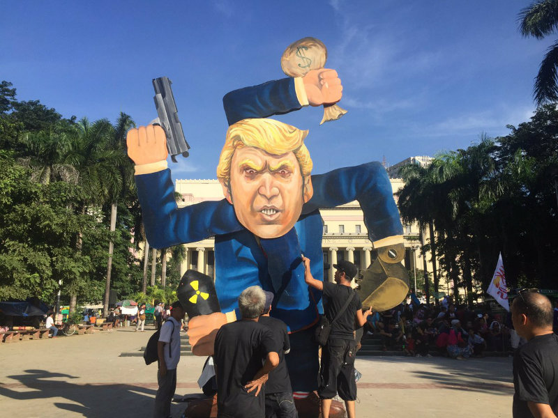 TRUMP EFFIGY. Put together by artist group Ugat Lahi, the effigy features US President Donald Trump with four arms resembling the swastika symbol. Photo by Raisa Serafica/Rappler