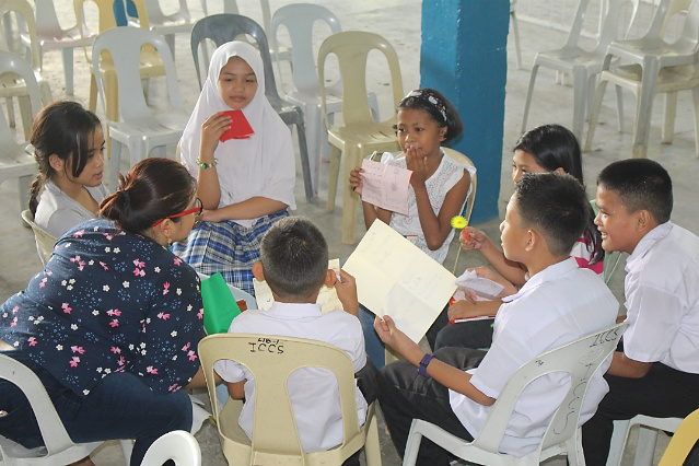 ASSISTANCE. The Department of Education provides psychological first aid to students displaced by the conflict in Marawi. Photo from the Department of Education