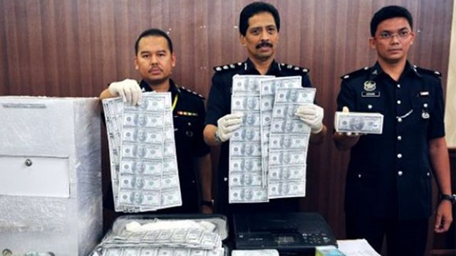 Filipino arrested in Malaysia over 'black money' racket
