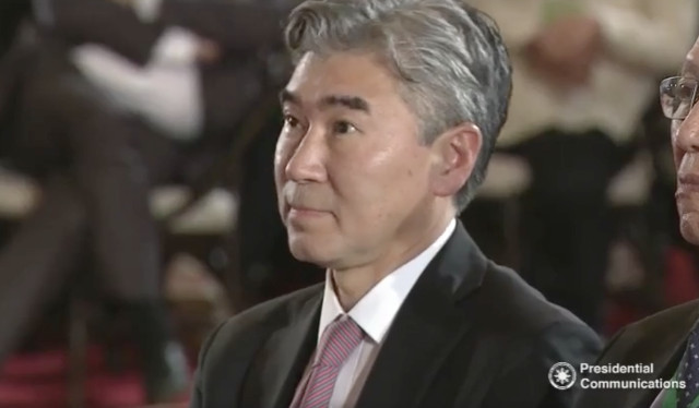 ON THE SPOT. US Ambassador Sung Kim listens to President Rodrigo Duterte's speech during a Go Negosyo Christmas Town Hall on December 19, 2016. Screenshot from RTVM