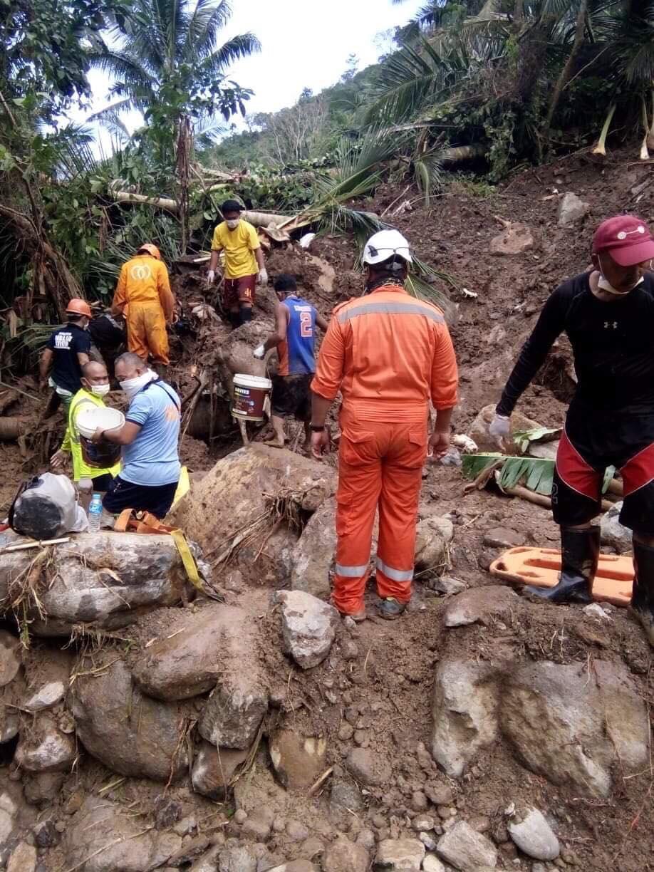 LANDSLIDE. Residents, policemen and rescue teams assess the landslide area in Barangay Patitinan, Sagñay, Camarines Sur. Photo courtesy of Radel Chavez Jr