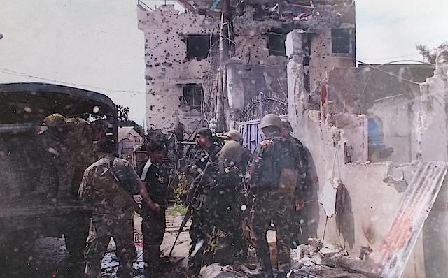 FORTRESS: The rogue MNLF fighters turned the KGK building into their headquarters. Photo from the LRB Gallery in Fort Bonifacio