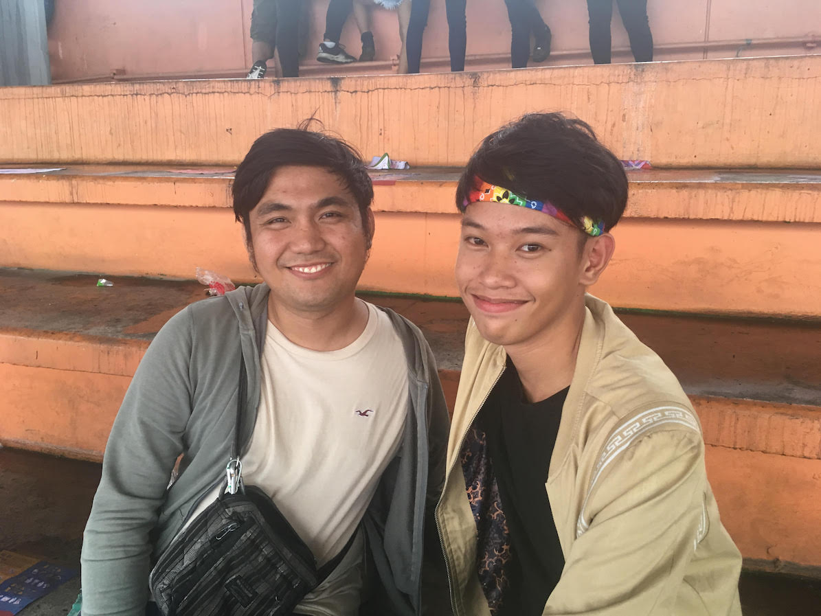 PRIDE 2019. John Lester Molina (left) and Angelous Tuscano (right), members of the Pinoy Deaf Rainbow, are happy to be celebrating Pride with all kinds of people. Photo by Stanley Guevarra/Rappler