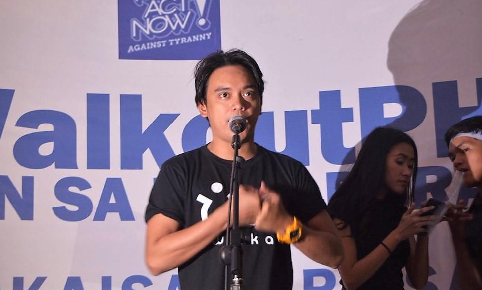 SPEAK UP. Spoken word poet Juan Miguel Severo performs a piece slamming the burial of former president Ferdinand Marcos at the Libingan ng mga Bayani in #WalkOutPH. Photo by Micah Simon
