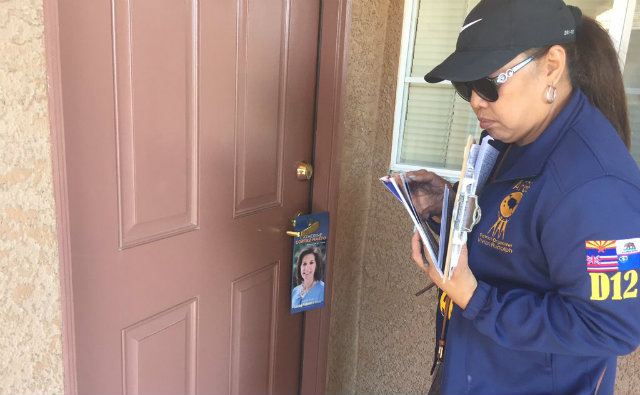 Vivian Rudolph, a Filipina-American volunteering for the Democratic Party, leaves a door hanger which urges support for Nevada senatorial candidate Catherine Cortez Masto. Photo by Ryan Songalia/Rappler