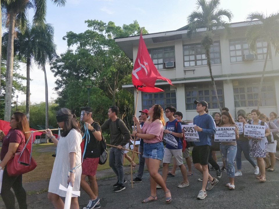 'STAND WITH CJ.' The UPLB Unbound, a multi-sectoral alliance of organizations in UPLB, denounces the ouster of Chief Justice Maria Lourdes Sereno. Photo by Dyl Dalas