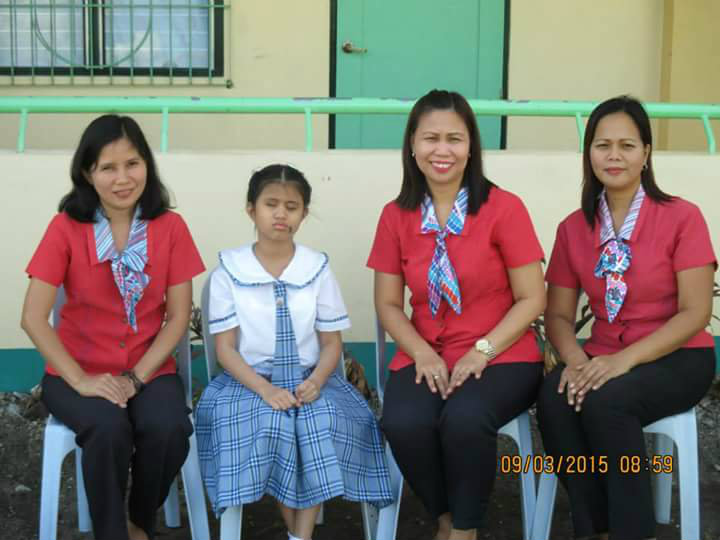 SPED program. Rawis Elementary School Principal Phoebe Santiago (center) says having the two teachers at Rawis Public Elementary School makes their special education institution ahead of others.