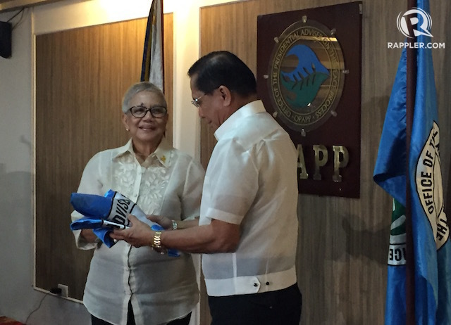 CALL IT 'CONTINUITY.' Former secretary Teresita 'Ging' Deles hands over the OPAPP flag to new peace adviser Jesus 'Jess' Dureza.