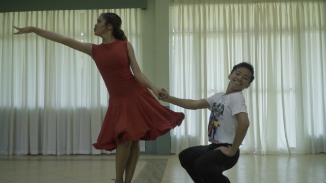 PARTNERS IN CRIME. Heather Parangan and Marc Layson practice their routine. Photo by Vee Salazar/ Rappler
