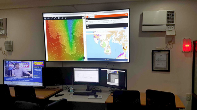 RED ALERT. The red alert light is switched on at the DSWD's new Virtual Operations Center (VOC) based in Quezon City, signalling the agency's heightened response to the southwest monsoon. Photo courtesy of Felino Castro V