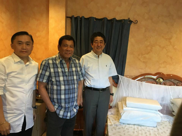 DUTERTE'S HOUSE. Japanese Prime Minister Shinzo Abe (1st from right) spends around 10 minutes in the room of Philippine President Rodrigo Duterte, and 45 minutes overall inside his Davao City home. Photo courtesy of Special Assistant to the President Bong Go