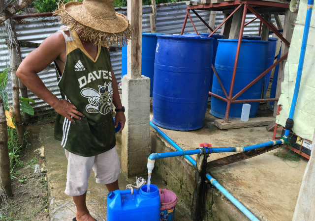CLEAN WATER. Residents in the island-village of Taloto-an enjoy clean water from the solar filtration system built by Iloilo CODE and Christian Aid. Photo by David Lozada/ Rappler