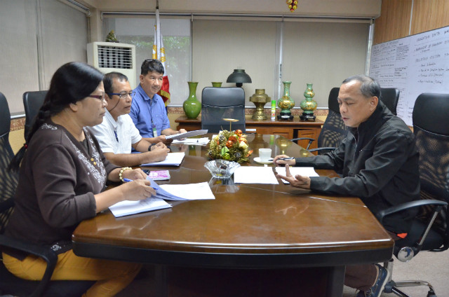 INITIAL REPORTS. NIA Administrator Peter Tiu Lavin receives initial reports on damaged irrigation facilities in areas hit by Typhoon Nina. Photo courtesy of NIA