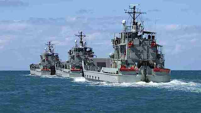 'AUSTRALIA'S GIFTS.' File photo of former Royal Australians Navy's Landing Craft Heavy (LCH) HMA Ships Brunei, Labuan and Tarakan depart Cairns Harbour in formation. Photo from the web site of the Australian Navy