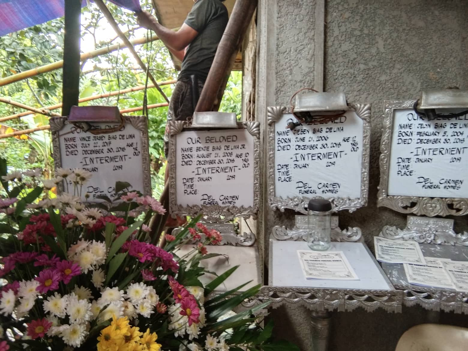 GRIEF. Four wake announcement boards welcome mourners at a house in San Vicente, Baao, Camarines Sur. Photo courtesy of Philippine Red Cross-CamSur