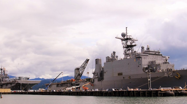 LANDING SHIPS. The dock landing ship USS Germantown (right) and the assault ship USS Bonhomme Richard occupy the length of the Alava Pier in the Subic Bay Freeport on Wednesday. The ships, along with USS Green Bay, are in port for replenishment before participating in the ongoing war maneuver between the Philippines and the United States.