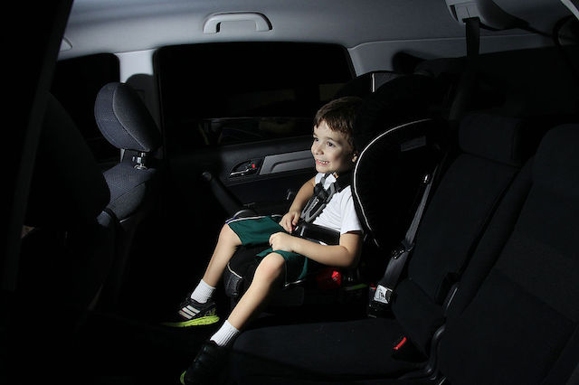 BUCKLING UP. Child safety seats can help prevent injuries in case of a crash. Photo by Senado Federal on Wikimedia Commons
