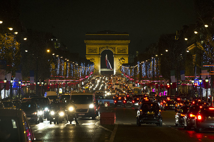 CITY OF LIGHT. Paris moves at the speed of light, life goes on. Photo by Etienne Laurent/EPA