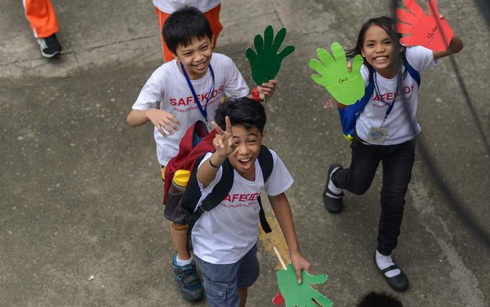 SAFE KIDS. Children celebrate the International Walk to School Week by conducting various activities to promote road safety. Photo by Heinz Orais/Safe Kids Philippines