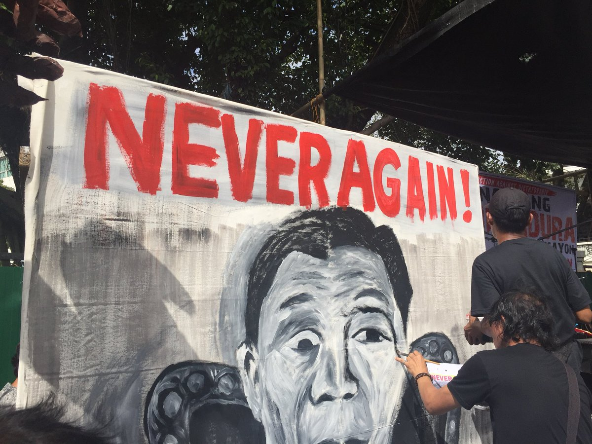 'NEVER AGAIN.' Iloilo artists prepare the placards for the protest activity on Friday, September 21, 2018. Photo by Carl Berwin/Rappler