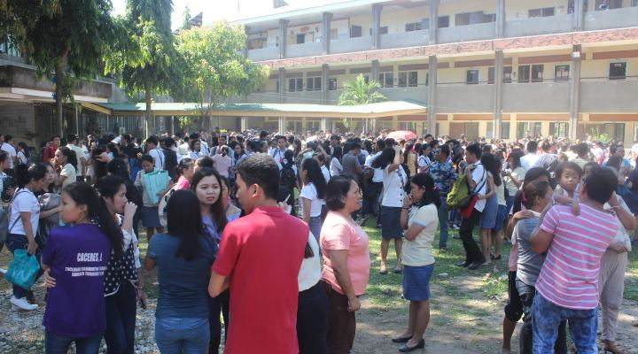 EVACUATION. Students of Leyte Normal University rush out of their buildings after an earthquake hits parts of the Visayas on Tuesday, April 23. Photo by Oliver Diaz