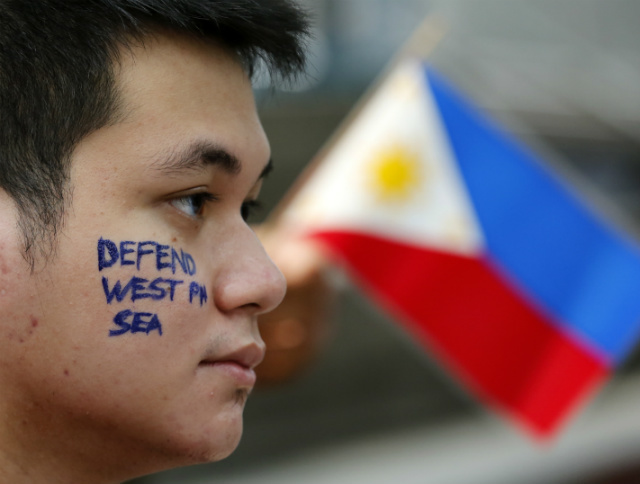 'DEFEND THE SEA.' A Filipino joins a demonstration in front of the Chinese consular office in Makati City on June 10, 2016, ahead of a historic ruling on the West Philippine Sea (South China Sea). Photo by Francis Malasig/EPA