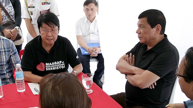 DISASTER RESPONSE. Social welfare Sec Judy Taguiwalo briefs President Rodrigo Duterte on the emergency responses for the quake-affected areas in Surigao province. Photo by Robinson Niñal/Malacañangl photo