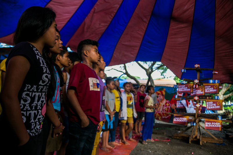 GOODBYE. Tribal students offer a song to guests and rights advocates as they bid farewell after months of staying in a protest camp in the University of the Philippines. Photo by Mark Saludes/Rappler