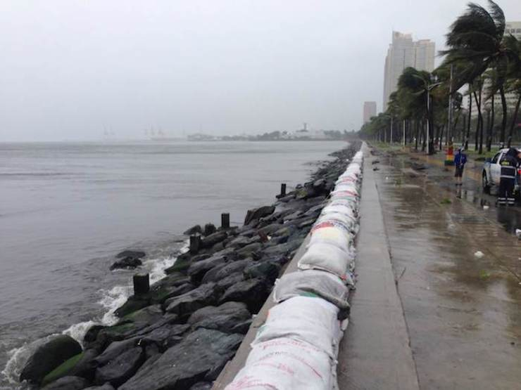 SEAWALL CONSTRUCTION NEEDED. The MMDA has lined the seawall along Manila Bay with sandbags to cushion any possible storm surge on July 16, 2014.