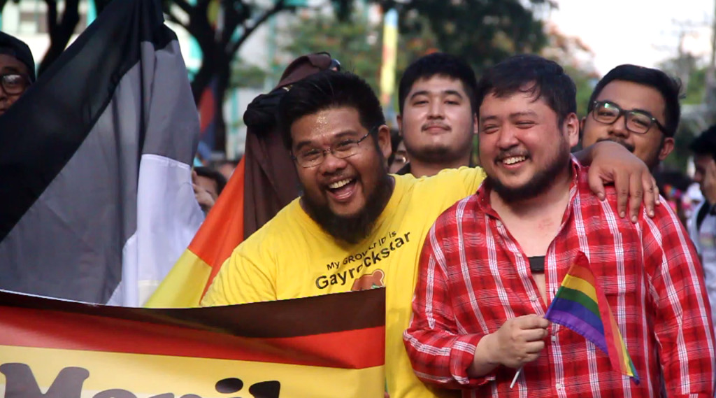 INCLUSIVITY. Ian Carandang (left) advocates for inclusivity at the 2017 Metro Manila Pride March. Photo by Adrianne Diaz