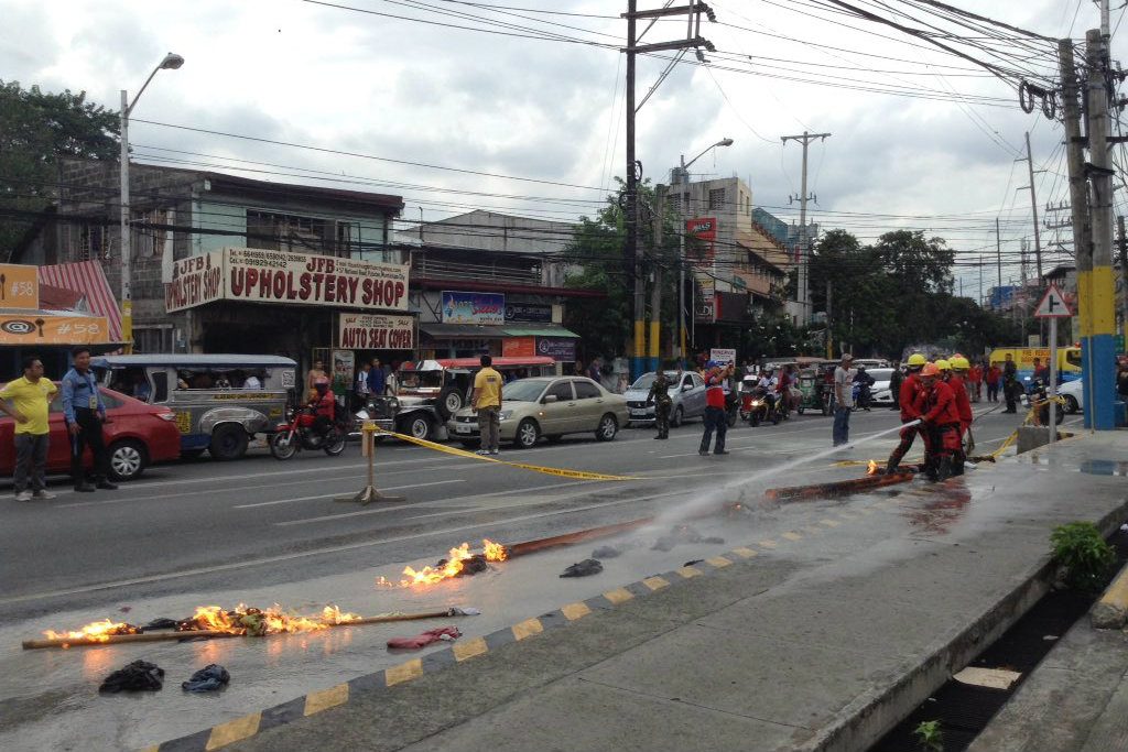 FIRE MANIPULATION. Bureau of Fire Protection backs up the Puregold Disaster Response Team in putting off a simulated fire from a fuel pipeline. Photo by Alexa Yadao/Rappler