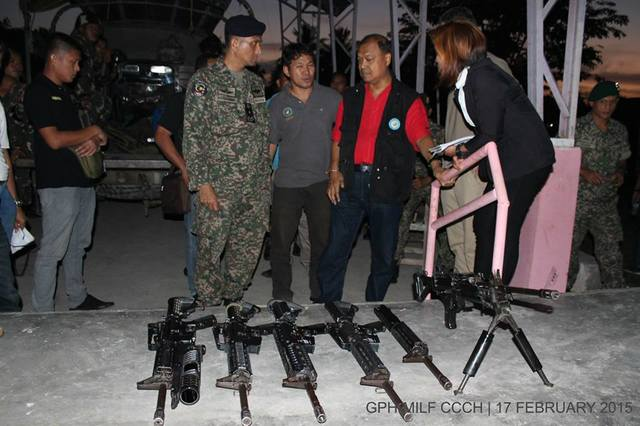 RETURNED. Members of the ceasefire committees of the government and the Moro Islamic Liberation Front inspect the weapons. Photo from OPAPP