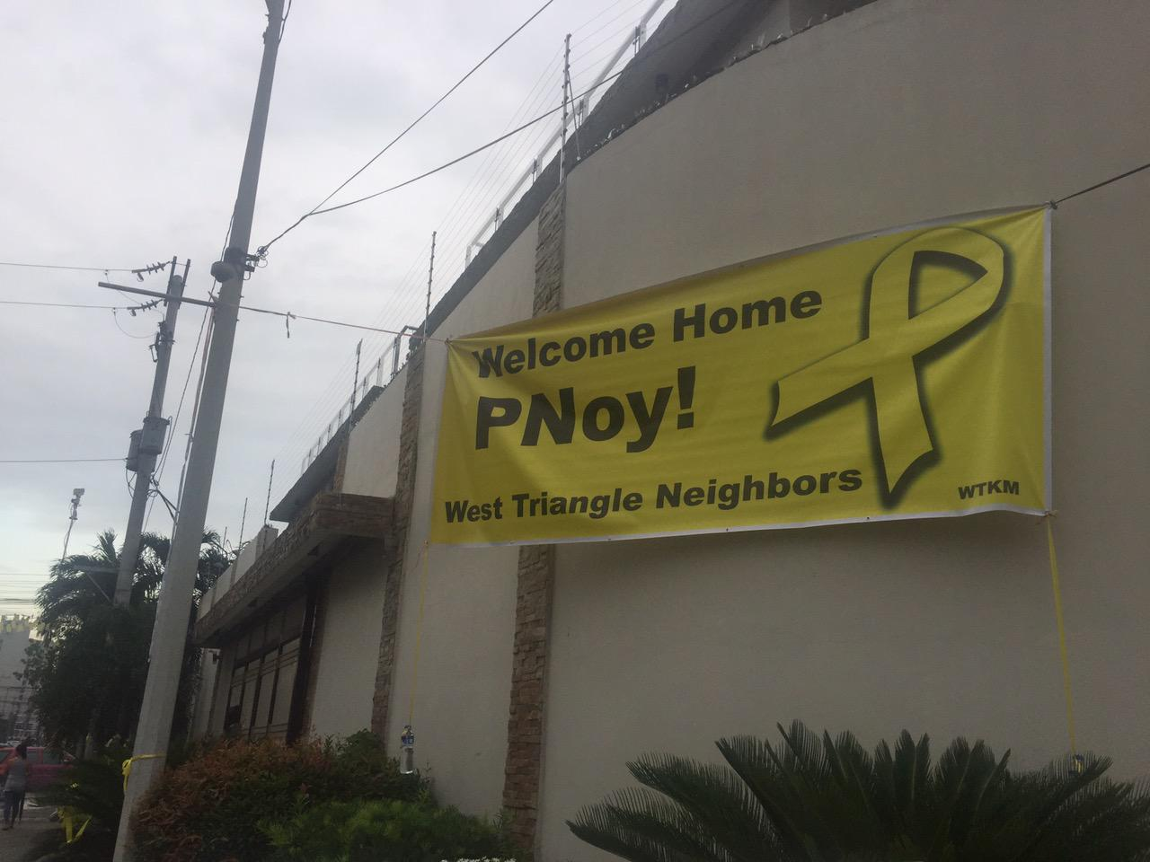 IN PHOTOS: QC neighbors welcome Aquino back