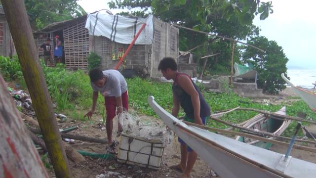 ILLEGAL. Fishermen in Barangay Poblacion, Carles town haul illegal fishing nets they caught on patrol. Photo by David Lozada/ Rappler