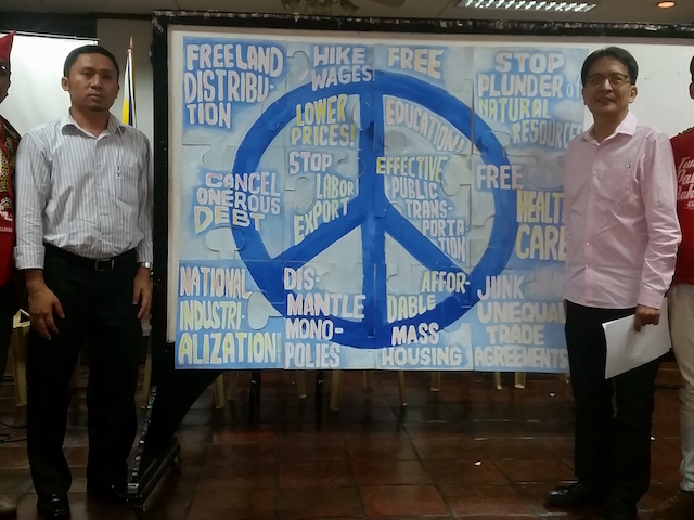 SOLVING PEACE. Piece by piece, a puzzle depicting peace was formed by the speakers of the press conference. Photo by Rambo Talabong