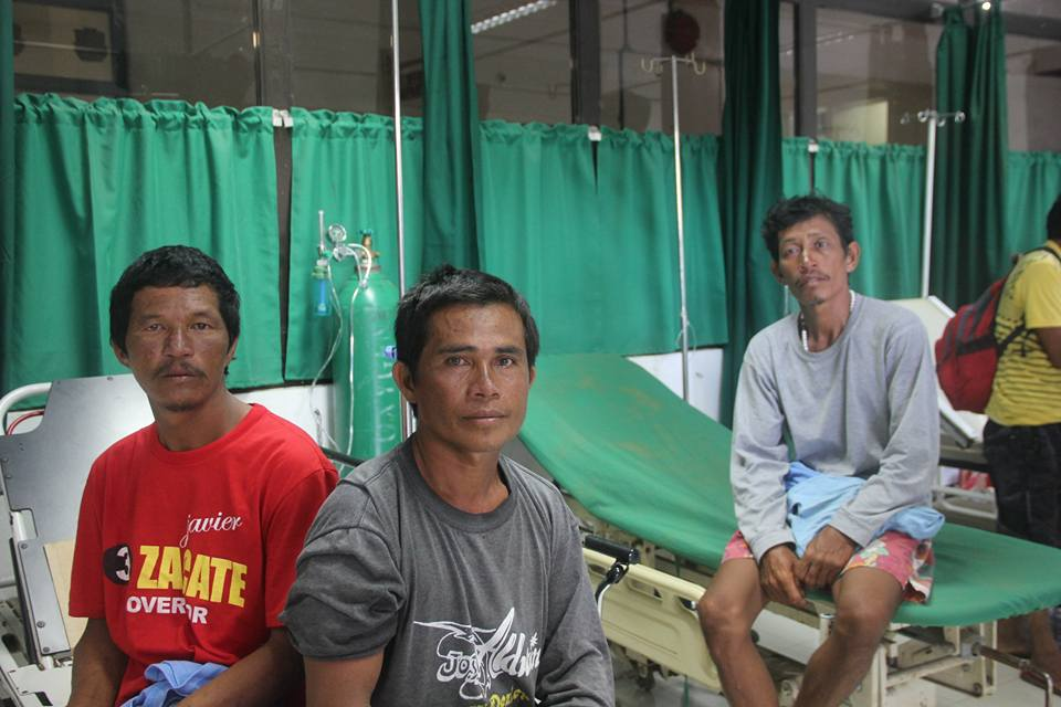 SURVIVORS. Catanduanes fishermen Rene Del Valle, Zaldy de Jesus, and Luis Tupig survived their 14-day ordeal in the middle of sea. Photo by Cora Basada